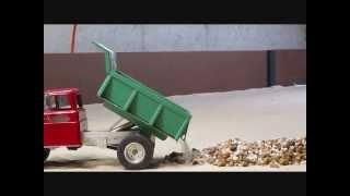 getlinkyoutube.com-RC Tonka Dump Truck hauling stone.