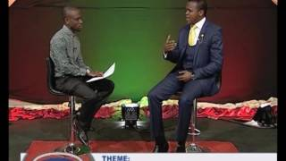 Yellow Dove (Antonio) chats with Pastor Choolwe of Gospel Envoys Church