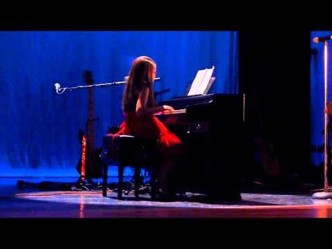 Karrisa Yapor on the Piano - Latin Music & Dance Studio