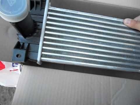 Где находится в Санг Янг Actyon Sports радиатор кондиционера