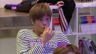 Wanna One watching horror movie together