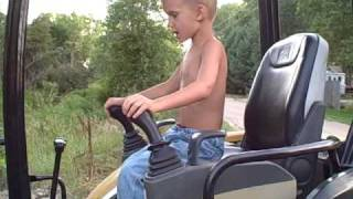 getlinkyoutube.com-5 & 6 Year Old Operating Cat 303 Excavator and Bobcat