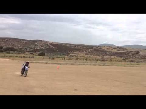 Theo and Anthony Riding Dirt Bikes