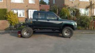 modified  toyota hilux pickup. rear coil spring conversion