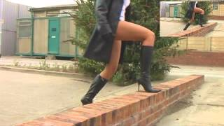 girl,in,leather,boots,pants,gloves,jacket,walking