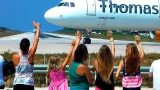 5 Girls waving pilots of starting planes at Skiathos St Maaren