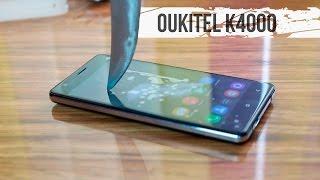 getlinkyoutube.com-Oukitel K4000. Распаковка, первый взгляд, резка телефона ножом.