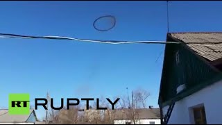 getlinkyoutube.com-Smoke machine? Portal to hell? Mysterious black ring in sky baffles Kazakh village