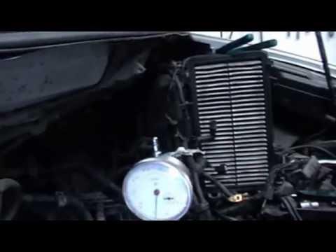 Где находится сальник двигателя у Mazda МПВ