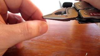 getlinkyoutube.com-Victorinox SwissTool vs. Original Leatherman multi-tools