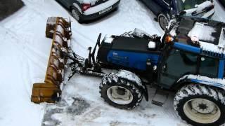getlinkyoutube.com-Parking lot snow plowing with Valmet 6800 tractor in Oslo, Norway