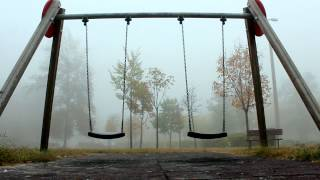 Swings in the fog. Long Shot.