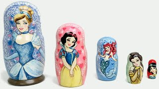 getlinkyoutube.com-Disney PRINCESS Stacking Cups Nesting Toys Surprise Cinderella Ariel Belle learn sizes & numbers
