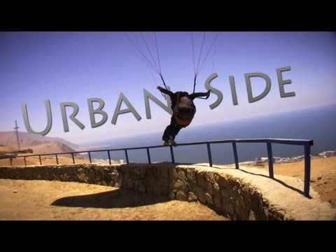 Urban Paraglider Swoops over the City