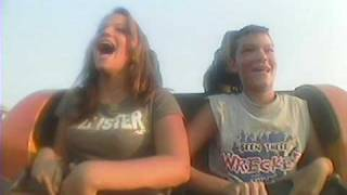 Brother and sister enjoy a comical roller coaster ride