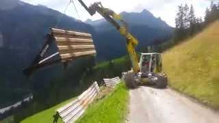 getlinkyoutube.com-Menzi Muck M545 beim Versetzen von Sicherungswänden - when moving safety walls