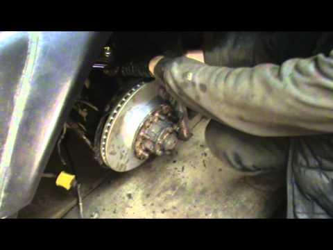 Где находятся передние тормозные диски в Мицубиси Паджеро Спорт