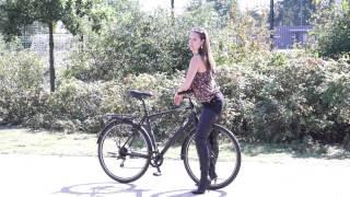 Karina on her bike with crotchhigh boots