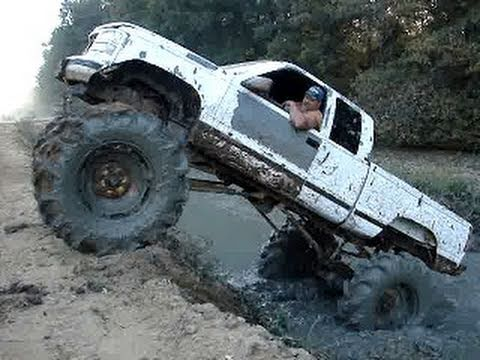 MUD TRUCK - CHEVY SILVERADO 4x4 on TRACTOR TIRES CLIMBS OUT OF GIANT HOLE!!