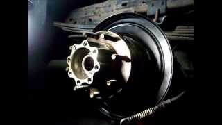getlinkyoutube.com-Ford F250 super duty `04 pt.3 back brake plate, e brake shoes, hub, and brake anchor plate