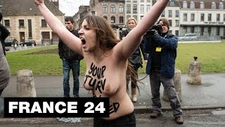 getlinkyoutube.com-FRANCE - Topless FEMEN protesters target former IMF director Strauss-Kahn at pimping trial