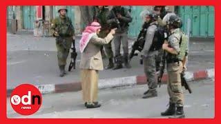 getlinkyoutube.com-Elderly Palestinian man confronts armed Israeli soldiers before collapsing
