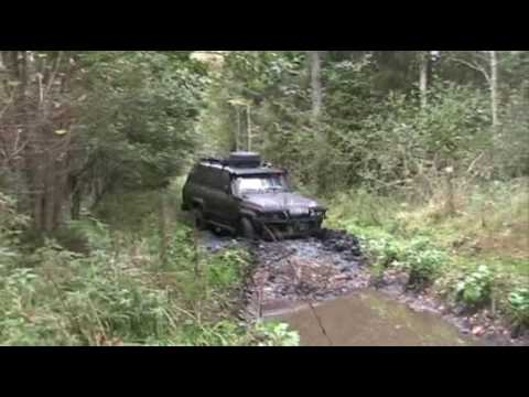 Landcruiser HJ61 and Patrol GR in mud