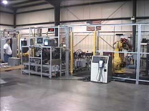 Dual-robot machine tool tending