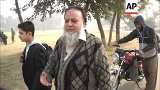 getlinkyoutube.com-Peshawar family loses a son in school massacre, while another son survives