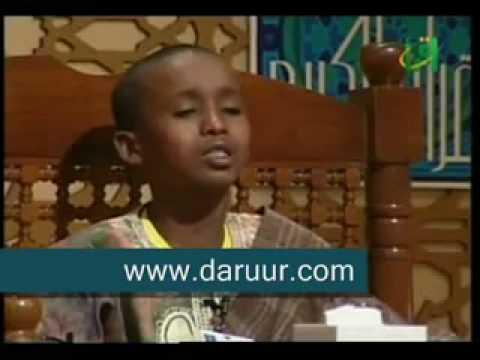a young boy weeping while reciting quran (somalia)