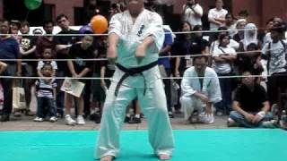 getlinkyoutube.com-singapore budokan kyokushin karate demo (part 5)-standing on eggs while breaking brick
