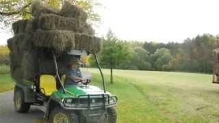 getlinkyoutube.com-John deere gator XUV hauling and pulling a full hay wagon