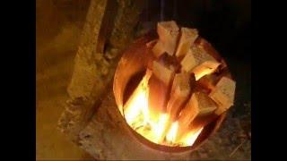 getlinkyoutube.com-rocket-stove - allumage.wmv