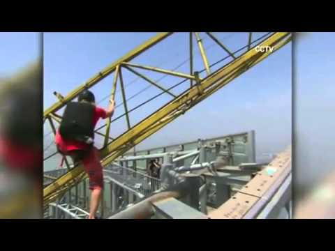 Austrian Michael Kemeter Climbs 900ft/275m Building, Base Jumps From Roof