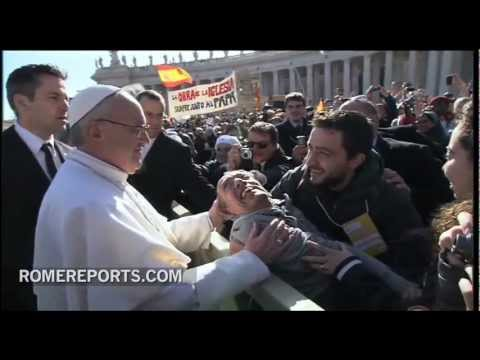 Pope gets out of Popemobile to bless disabled man before Inaugural Mass