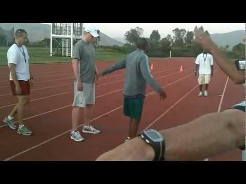 Coach Smith Talks Mile Relay Exchanges...