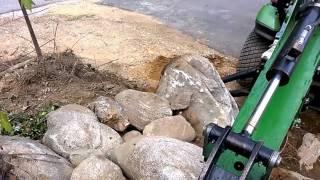 getlinkyoutube.com-Rock Walls - Using the Backhoe to help move rocks!