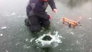 getlinkyoutube.com-Giant Bass Caught Through The Ice!! Tip Ups Nov. 2012