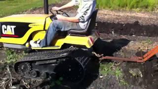 getlinkyoutube.com-Mini Cat Challenger plowing potatoes