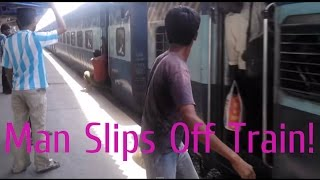 getlinkyoutube.com-Funny Train Accident Videos! Man Slips off Train India [Indian Railways]