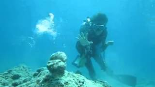 Diver Knocks Rocks With Air Ring Video