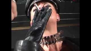 getlinkyoutube.com-Dominatrix Dinah - The leather Mistress is smoking a cigarette