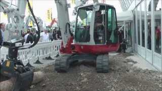 getlinkyoutube.com-Takehuchi excavator with amazing attachments
