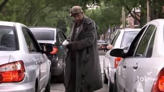 Cerșetor printre mașini