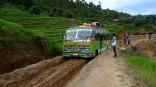 getlinkyoutube.com-TATA Power! TATA Bus traverses a muddy dirt road in Nepal