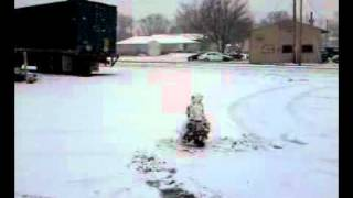 A snowman gets hit by a truck wearing a hat.