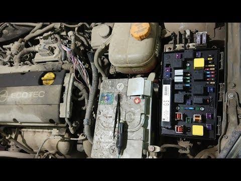 Расположение датчика температуры антифриза в Opel Тигра