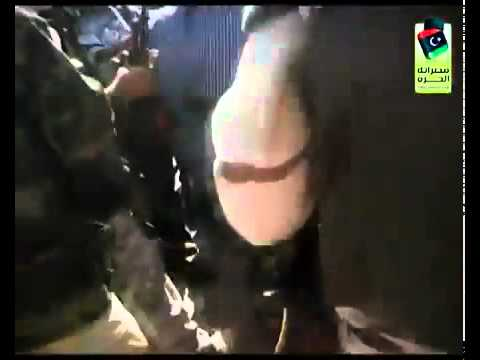 Muammar Gaddafi's Last Moments - He is dragged to a truck and killed.