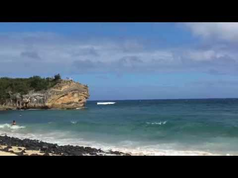 Jumping of the cliff at shipwreck beach close to Grand Hyatt, kauai