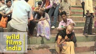getlinkyoutube.com-Indian women getting their heads shaved at Varanasi ghat